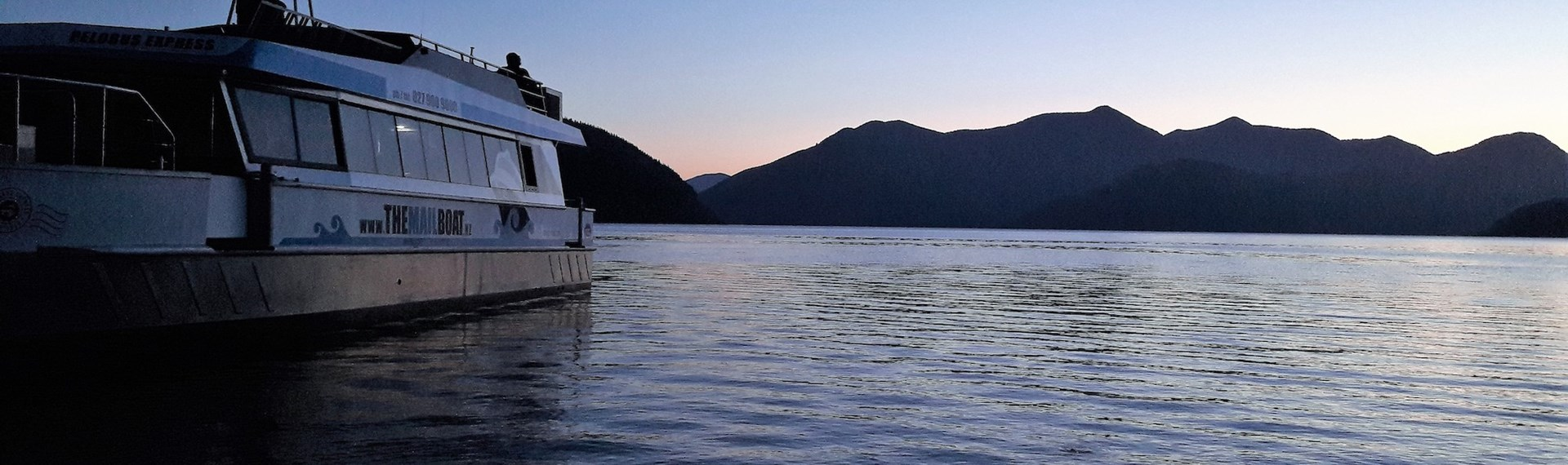 Pelorus Mail Boat at sunset in the water during a charter.