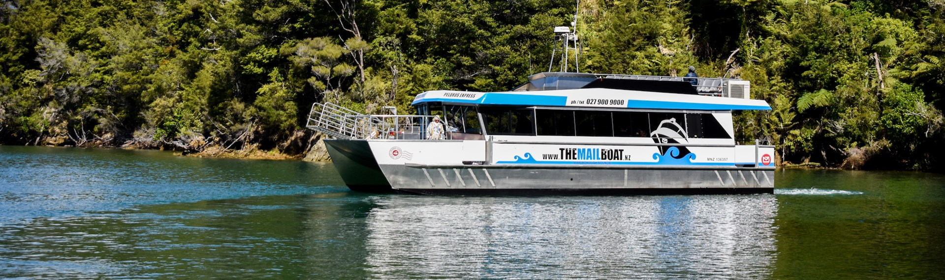 The Pelorus Mail Boat exploring a bay in Pelorus Sound/Te Horiere.